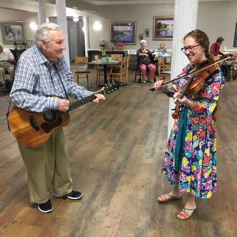 Fiddle and guitar players at a Senior Living Home in Oklahoma City.