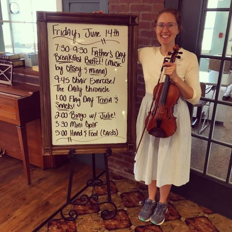 Senior Living musician Minna Biggs plays her fiddle at the Senior Living Father's Day Celebration.